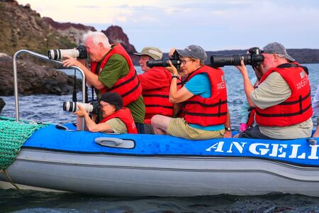 bartolome: Group of tourists photographing from a dinghy near Bartolome island in Galapagos National Park, Ecuador.