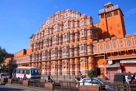 latticework: Hawa Mahal with road traffic in front of it, Jaipur, Rajasthan, India. Hawa Mahal was designed by Lal Chand Ustad in the form of the crown of Krishna, the Hindu god.