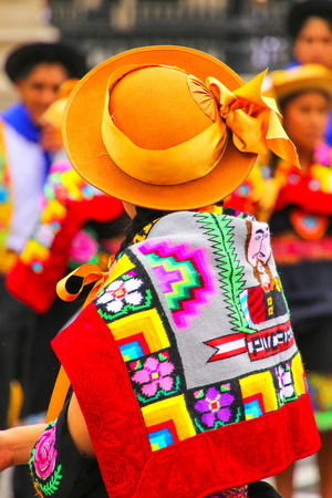 back cloth: Woman wearing traditional hat and back cloth during Festival of the Virgin de la Candelaria in Lima, Peru. The core of the festival is dancing and music performed by different dance schools. Editorial