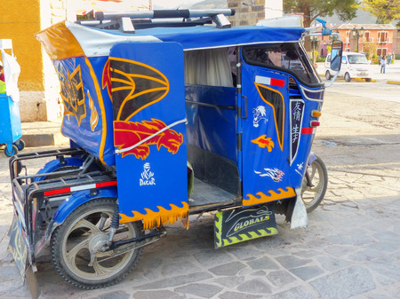 auto rickshaw: Auto rickshaw parked in the street of Chivay town, Peru. Chivay town is the capital of Caylloma province.