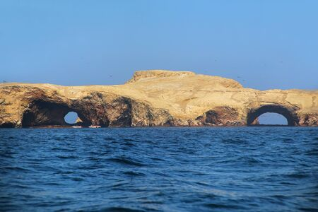 fauna: Rock formations in Ballestas Islands Reserve in Peru. Ballestas islands are an important sanctuary for marine fauna Stock Photo