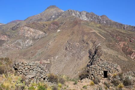 food storage: Pre-Incan round houses named colca near Chivay in Peru. Colcas are circular stone structures used for food storage or burials.