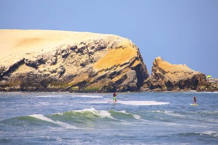 Rock formations and waves in Punta Hermosa, Peru. Punta Hermosa is a popular beach town not far from Lima.
