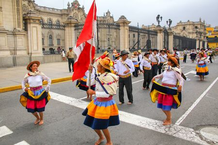 Local people dancing during Festival of the Virgin de la Candelaria in Lima, Peru. The core of the festival is dancing and music performed by different dance schools.