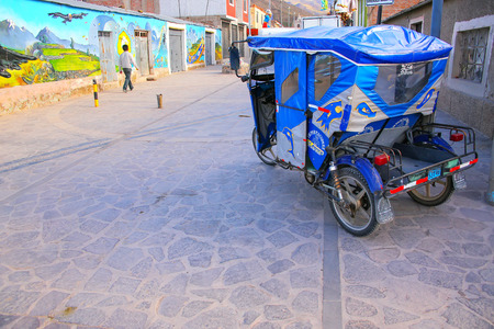 mototaxi: Auto rickshaw parked in the street of Chivay town, Peru. Chivay town is the capital of Caylloma province.
