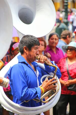 local festivals: Local man playing sousaphone during Festival of the Virgin de la Candelaria in Lima, Peru. The core of the festival is dancing and music performed by different dance schools.