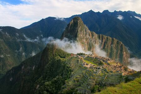voted: Inca citadel Machu Picchu with morning fog, Peru. In 2007 Machu Picchu was voted one of the New Seven Wonders of the World. Stock Photo
