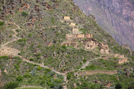 conquered: Inca storehouses on the hill surrounding Ollantaytambo, Peru. Ollantaytambo was the royal estate of Emperor Pachacuti who conquered the region.