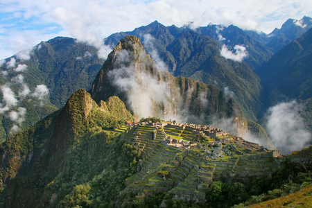 Inca citadel Machu Picchu with morning fog, Peru. In 2007 Machu Picchu was voted one of the New Seven Wonders of the World. Stock Photo