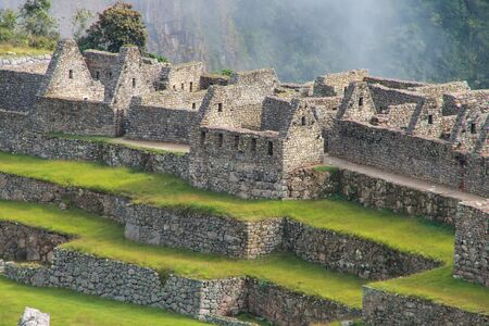 voted: Close view of the ruins at Machu Picchu citadel in Peru. In 2007 Machu Picchu was voted one of the New Seven Wonders of the World. Stock Photo
