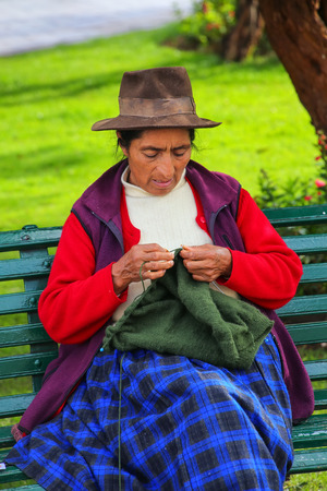 typical: Local woman knitting at Plaza de Armas in Cusco, Peru. In 1983 Cusco was declared a World Heritage Site by UNESCO