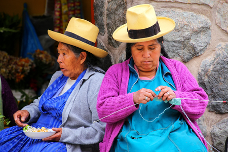 typical: Local women sitting at the market in Ollantaytambo, Peru. Ollantaytambo was the royal estate of Emperor Pachacuti who conquered the region.