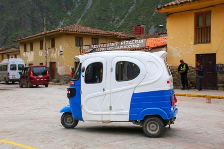 auto rickshaw: Auto rickshaw in the street of Ollantaytambo, Peru. Ollantaytambo was the royal estate of Emperor Pachacuti who conquered the region. Editorial