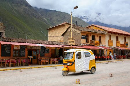 conquered: Auto rickshaw in the street of Ollantaytambo, Peru. Ollantaytambo was the royal estate of Emperor Pachacuti who conquered the region. Editorial