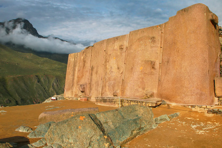 Wall of the Six Monoliths at Inca Fortress in Ollantaytambo, Peru. Ollantaytambo was the royal estate of Emperor Pachacuti who conquered the region. Stock Photo