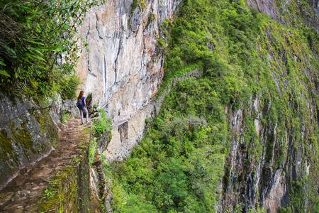 The Inca Bridge near Machu Picchu in Peru. This Bridge is a part of a mountain trail that heads west from Machu Picchu