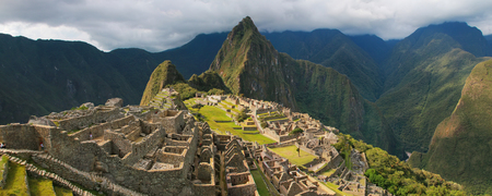 Panorama of the Incan citadel Machu Picchu in Peru. In 2007 Machu Picchu was voted one of the New Seven Wonders of the World. Stock Photo