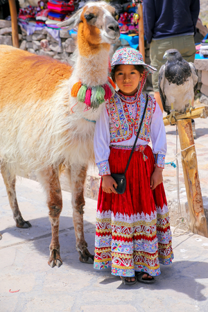 eagle canyon: Local girl in traditional dress standing at the market in Maca village in Colca Canyon, Peru. Maca is one of the three main tourist towns of the Colca Canyon.