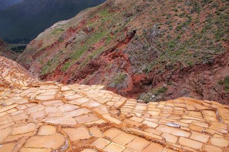 evaporacion: Salinas de Maras - salt evaporation ponds near town of Maras in Peru. These salt pans are in use since Inca times.