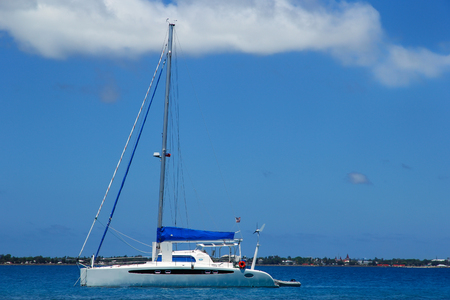 Sailboat anchired near Pangaimotu island in Tonga. Kindom of Tonga is an archipelago comprised of 169 islands