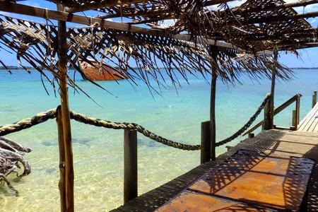 Wooden pier at Pangaimotu island near Tongatapu in Tonga. Kindom of Tonga is an archipelago comprised of 169 islands