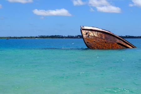 Shipwreck off the coast of Pangaimotu island near Tongatapu island in Tonga. Kindom of Tonga is an archipelago comprised of 169 islands Stock Photo