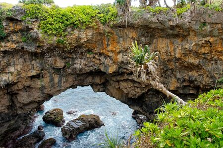 Natural land bridge Hufangalupe on the southern part of Tongatapu island in Tonga. It was formed when the roof of a sea cave collapsed Stock Photo