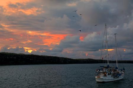 great bay: Sailboat at sunrise in Great Darwin Bay, Genovesa Island, Galapagos National Park, Ecuador