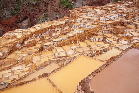 evaporacion: Salinas de Maras - salt evaporation ponds near town of Maras in Peru. These salt pans are in use since Inca times.