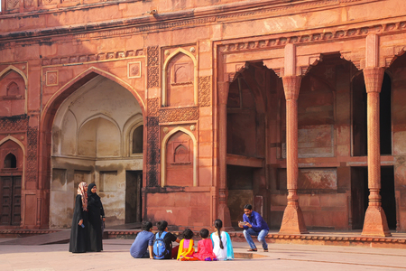 uttar pradesh: Visitors taking pictures in the courtayrd of Jahangiri Mahal in Agra Fort, Uttar Pradesh, India. The fort was built primarily as a military structure, but was later upgraded to a palace.