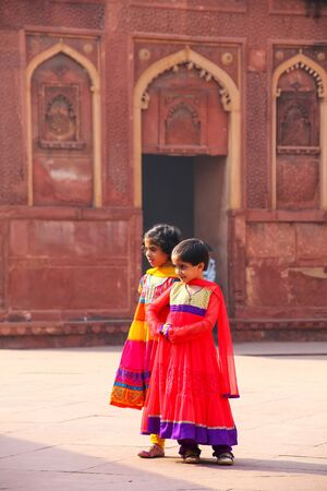 Young girls walking in Jahangiri Mahal in Agra Fort, Uttar Pradesh, India. The fort was built primarily as a military structure, but was later upgraded to a palace. Editorial