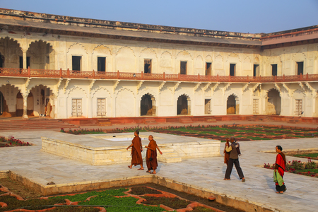 uttar pradesh: Visitors walking around Anguri Bagh (Grape Garden) in Agra Fort, Uttar Pradesh, India. The fort was built primarily as a military structure, but was later upgraded to a palace.