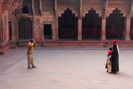 uttar pradesh: Visitors taking pictures in Jahangiri Mahal in Agra Fort, Uttar Pradesh, India. The fort was built primarily as a military structure, but was later upgraded to a palace. Editorial