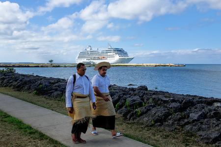 Local men walking at the waterfront in Nukualofa on Tongatapu island, Tonga. NukuÊ»alofa is the capital of the Kingdom of Tonga Editorial