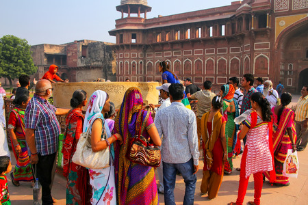 uttar pradesh: Group of local people standing outside Jahangiri Mahal in Agra Fort, Uttar Pradesh, India. The fort was built primarily as a military structure, but was later upgraded to a palace.
