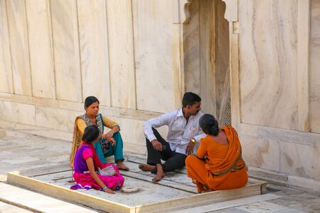 uttar pradesh: People sitting at Nagina Masjid (Gem Mosque) in Agra Fort, Uttar Pradesh, India. It was build in 1635 by Shah Jahan for the ladies of his harem and made entirely of marble