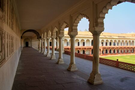 uttar pradesh: Colonnade walkway leading to Diwan-i- Khas (Hall of Private Audience) in Agra Fort, Uttar Pradesh, India. The fort was built primarily as a military structure, but was later upgraded to a palace.