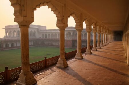 Colonnade walkway leading to Diwan-i- Khas (Hall of Private Audience) in Agra Fort, Uttar Pradesh, India. The fort was built primarily as a military structure, but was later upgraded to a palace.