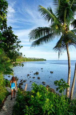 Young woman hiking Lavena Costal Walk on Taveuni Island, Fiji. Taveuni is the third largest island in Fiji.