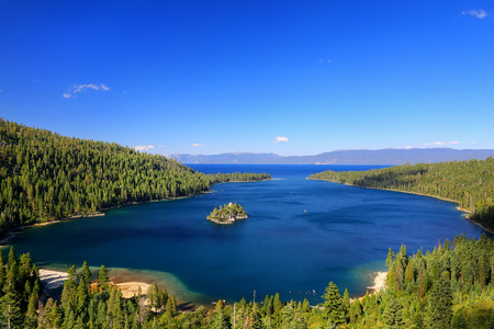 Emerald Bay at Lake Tahoe with Fannette Island, California, USA. Lake Tahoe is the largest alpine lake in North America Imagens