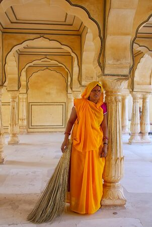 archways: Local woman standing in Sattais Katcheri Hall, Amber Fort, Jaipur, India. Amber Fort is the main tourist attraction in the Jaipur area. Editorial