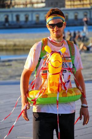 Young man taking part in The Color Run in Trieste, Italy. Trieste is the capital of the autonomous region Friuli-Venezia Giulia