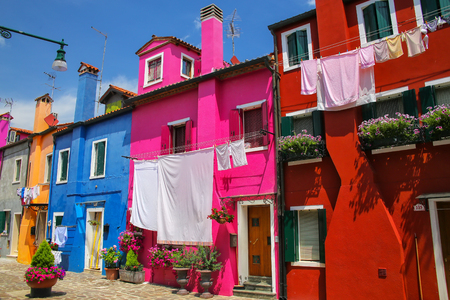 Colorful houses in Burano, Venice, Italy. Burano is an island in the Venetian Lagoon and is known for its lace work and brightly colored homes.