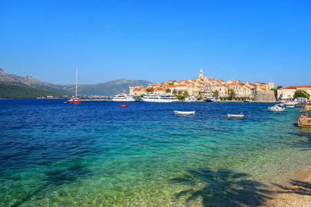 dalmatia: Clear water at the waterfront of Korcula town, Croatia. Korcula is a historic fortified town on the protected east coast of the island of Korcula Stock Photo
