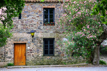 Facade of an old stone building in Colonia del Sacramento, Uruguay. It is one of the oldest towns in Uruguay