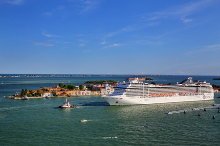 Cruise ship moving through San Marco canal in Venice, Italy. Venice is situated across a group of 117 small islands that are separated by canals and linked by bridges. Editorial