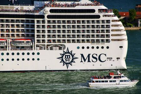 Detail of MSC cruise ship moving through San Marco canal in Venice, Italy. MSC is the world's second largest shipping line in terms of container vessel capacity and also owns 12 cruise ships.