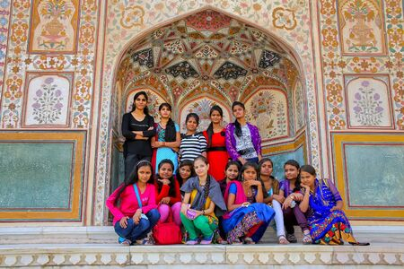 Group of young women gathering at Ganesh Pol in Amber Fort, Rajasthan, India. Ganesh Pol was a gateway to the maharaja's appartments. Sajtókép