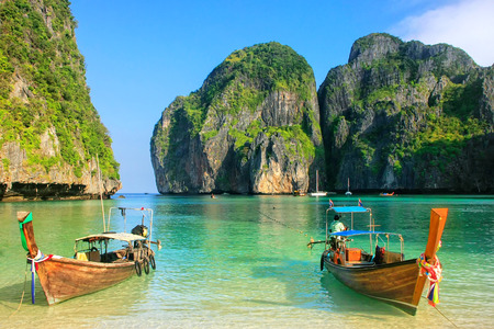 Longtail boats anchored at Maya Bay on Phi Phi Leh Island, Krabi Province, Thailand. It is part of Mu Ko Phi Phi National Park. Zdjęcie Seryjne