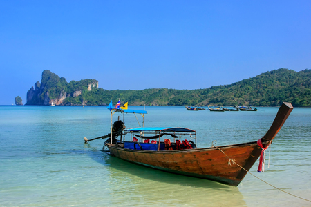 Longtail boat anchored at Ao Loh Dalum beach on Phi Phi Don Island, Krabi Province, Thailand. Koh Phi Phi Don is part of a marine national park. Stock Photo